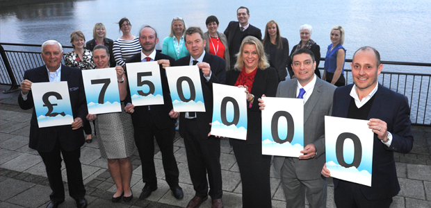 Patrons of Middlesbrough and Teesside Philanthropic Foundation are joined by charity representatives in celebrating the £750,000 fundraising milestone.